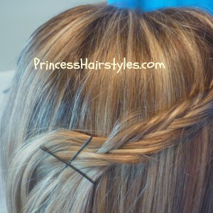 fishtail braid pin back hairstyle