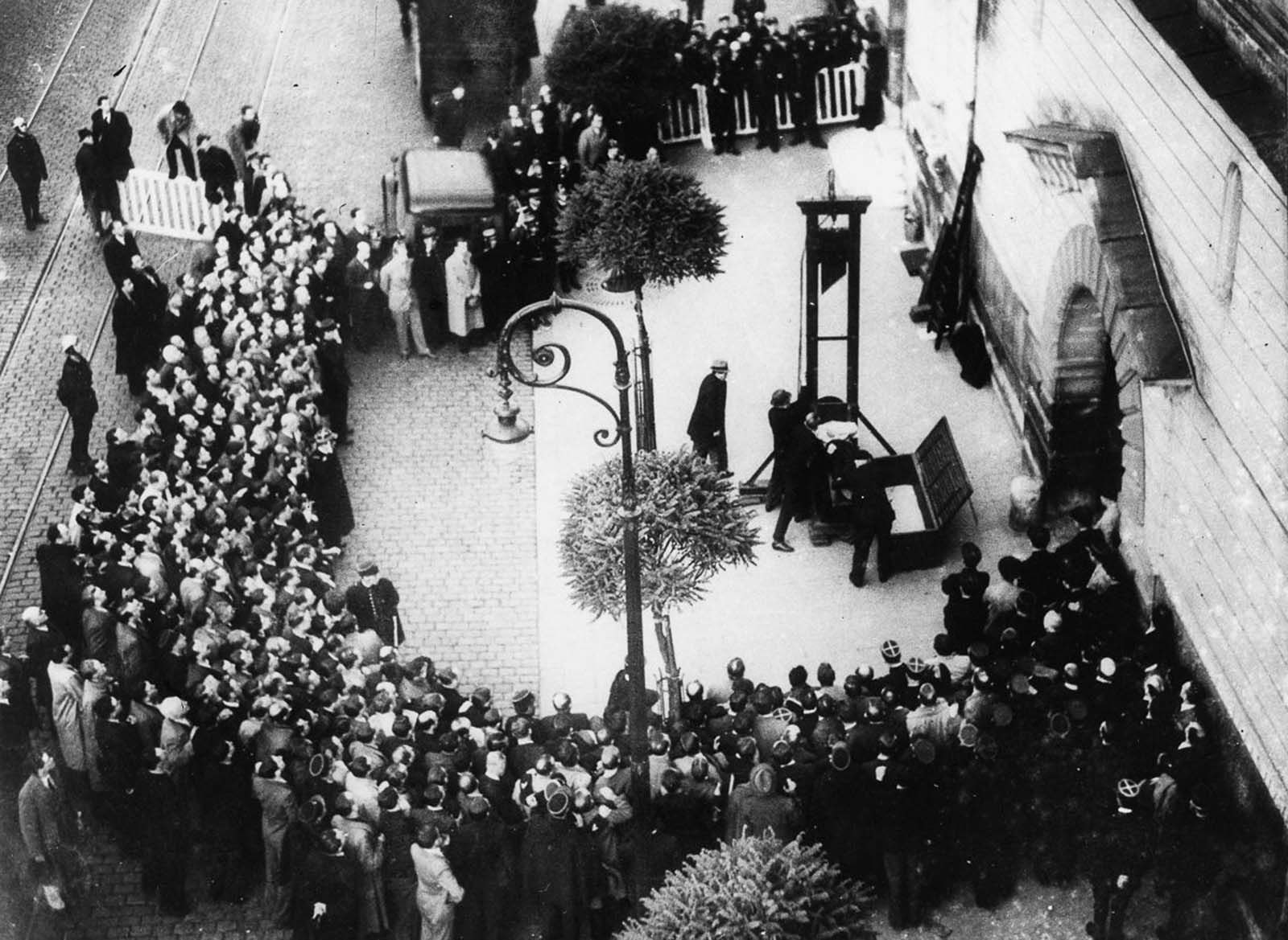 Weidmann is placed in the guillotine seconds before the blade falls.
