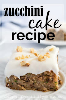 slice of zucchini cake with cream cheese frosting and walnuts