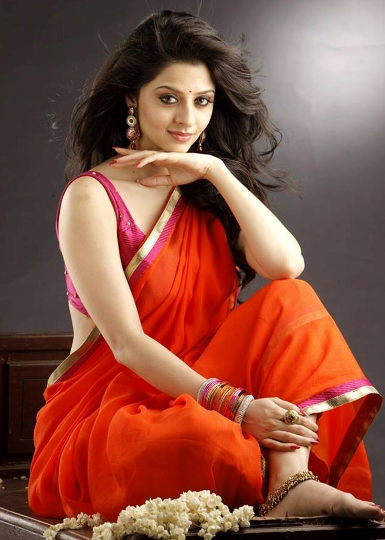 Vedika Hot Navel Show Photos in Orange Saree