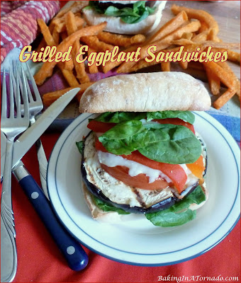 Grilled Eggplant Sandwiches are a healthy, hearty meal. Grilled eggplant is topped with cheese and vegetables, and served on a toasted Ciabatta. | Recipe developed by www.BakingInATornado.com | #recipe #sandwich