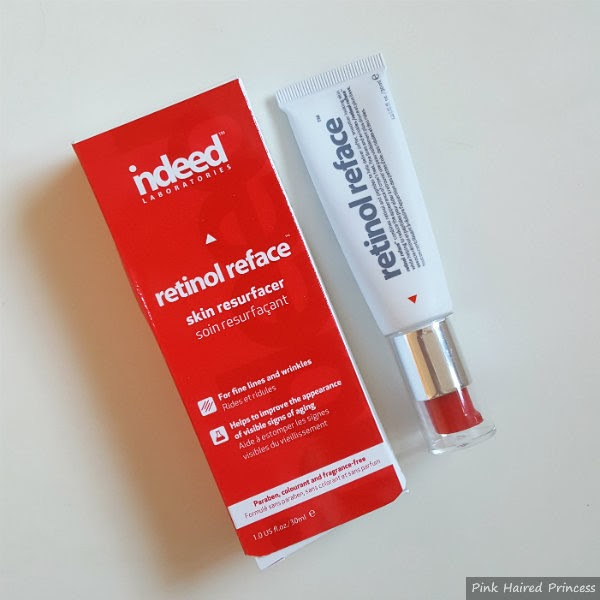 Red cardboard box of Retinol Reface sitting next to white tube of Retinol Reface