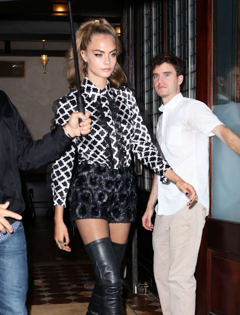 Cara Delevingne in thigh high boots and short shorts out in New York