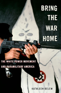 Cover of Bring the War Home, showing man pointing automatic weapon with KKK robe in background