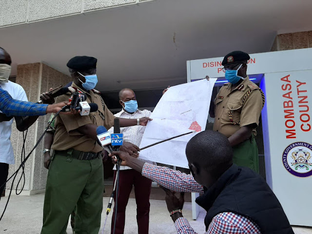 Mombasa county commissioner Gilbert Kitiyo displays the area under containment to journalists outside his Uhuru na Kazi office on Wednesday evening.