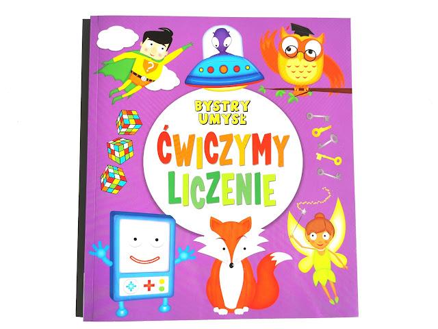 na zdjęciu okładka książki ćwiczymy liczenie, okłądak jest w kolorze fioletowym, an środku białe koło z tytułem a wokoło kolorowe obrazki