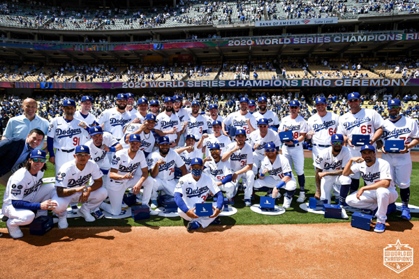 The Los Angeles Dodgers pose with their 2020 World Series championship rings prior to defeating the Washington Nationals, 1-0, at Dodgers Stadium...on April 9, 2021.