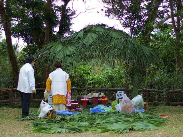 straw-roofed hut and preparations for blessings