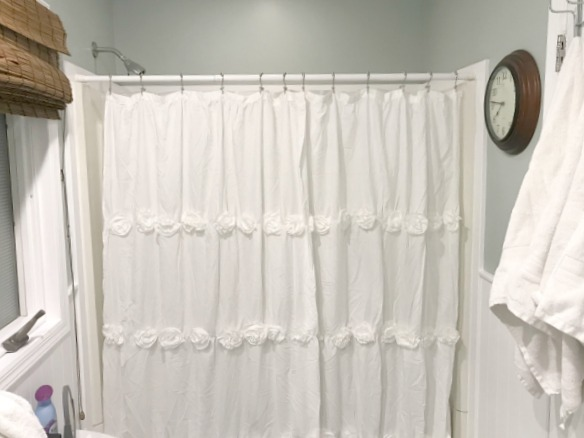 A neutral farmhouse bathroom makeover and a rosette shower curtain