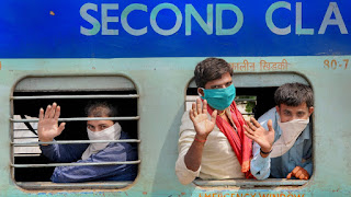 Migrants taking trains during COVID-19 in India