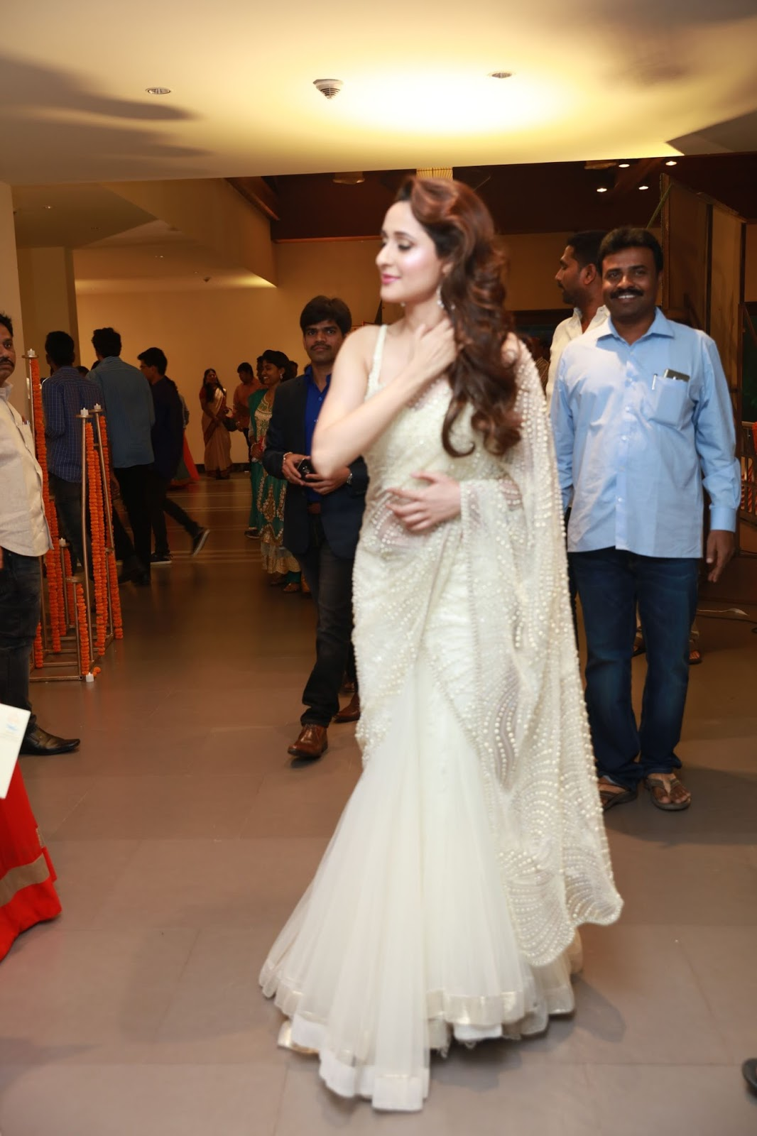 Pragya Jaiswal Photos In White Saree At Director Krish Marriage