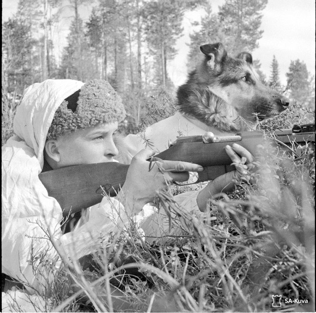Finnish soldier and dog 25 April 1942 worldwartwo.filminspector.com