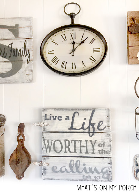 gallery wall with farmhouse clock, wood sign, pulley