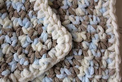 crochet baby blanket made from yarn.