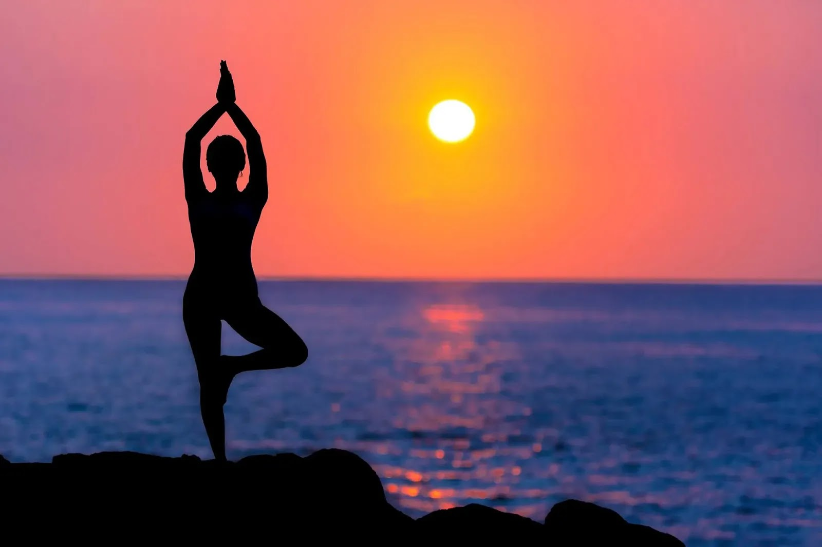 woman doing yoga at sunset%25281%2529 result