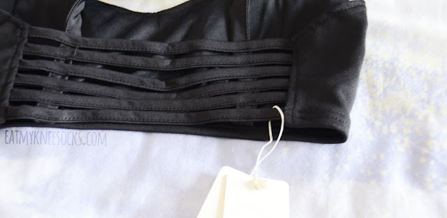 Details on the black caged cutout bralette crop top from Dresslink.