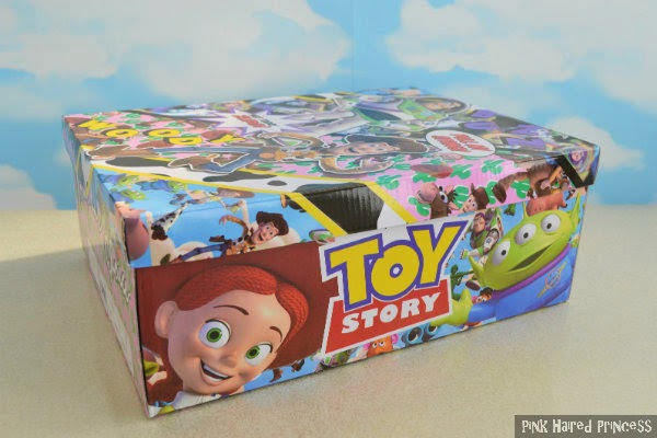 side of shoe box with Jessie and alien faces from Toy Story with branding in centre