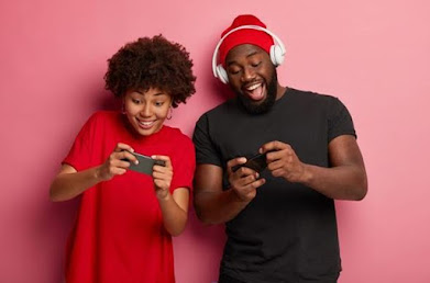 young man and woman pressing smartphone