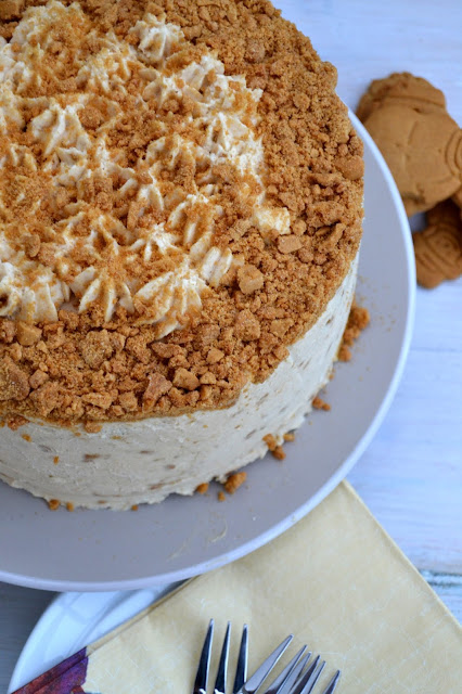 Dark gingerbread cake with cream cheese frosting incorporating crushed ginger nut biscuits