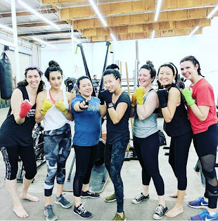 Maurene with friends at boxing class