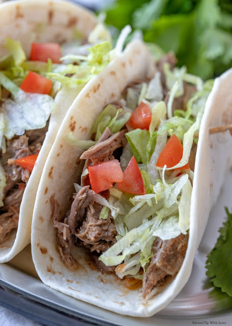 Easy Crock Pot Shredded Beef Tacos recipe from Served Up With Love