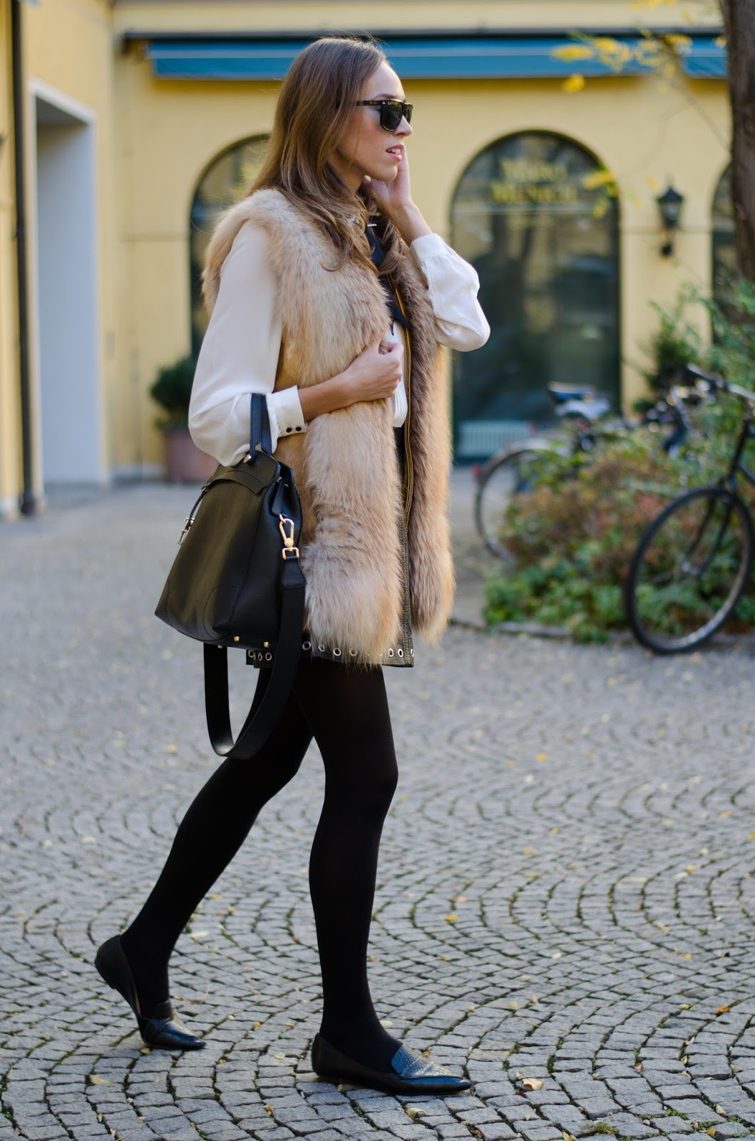 kristjaana mere fox fur vest leather skirt fall outfit fashion