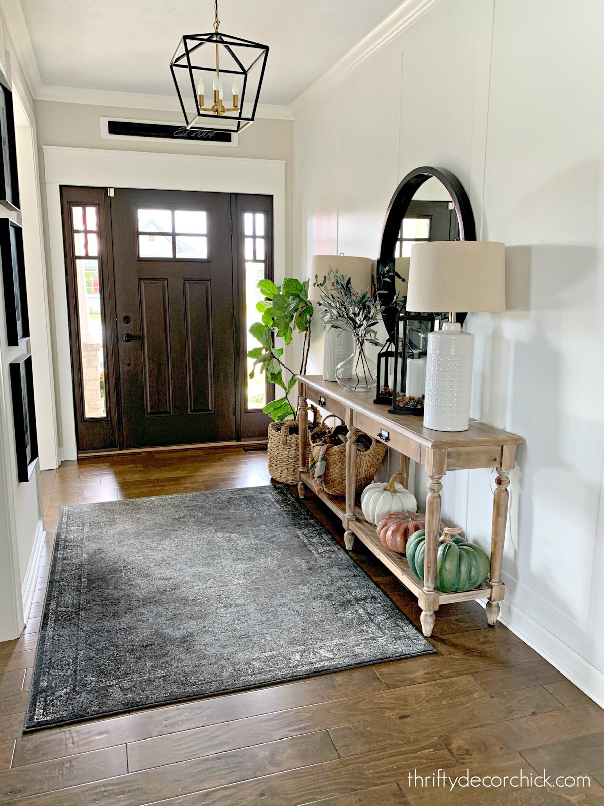 foyer with Everett table and white walls with molding