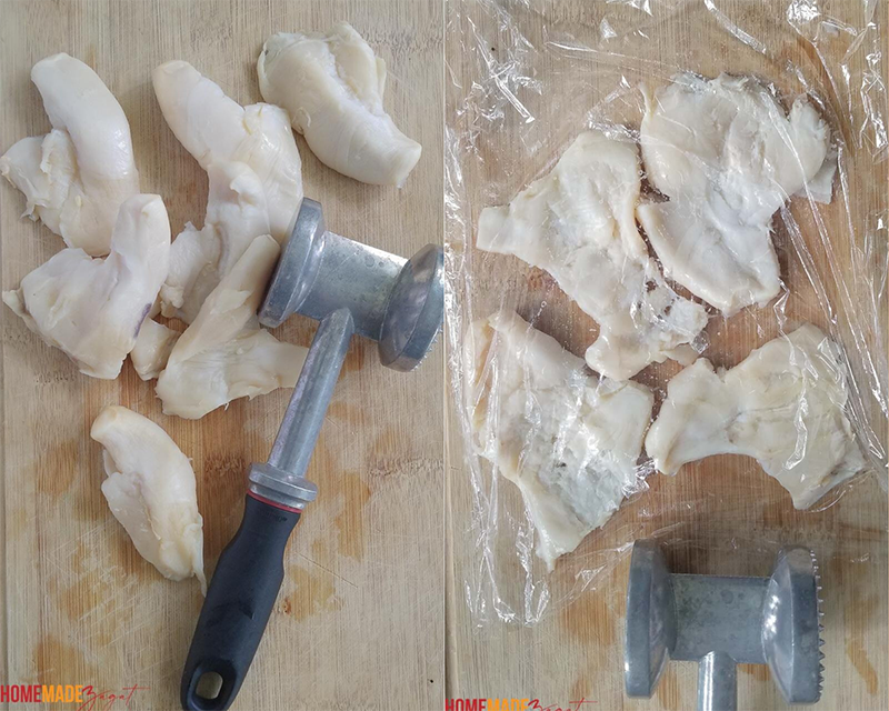 COnch meat before being tenderized then covered with plastic warp to tenderize