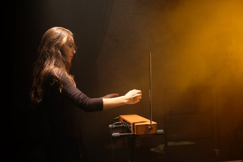 girl playing theremin