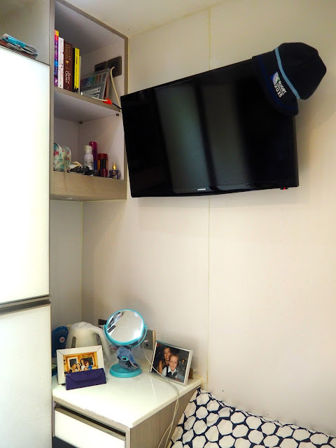 Table, shelves and TV in my studio apartment in Sham Shui Po, Kowloon, Hong Kong