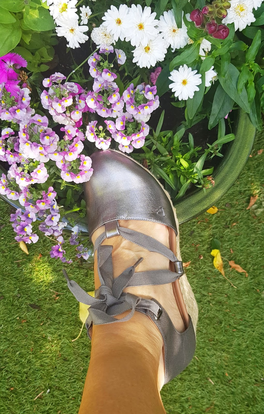 Close up of Vionic Kaitlyn wedge sandals in pewter leather