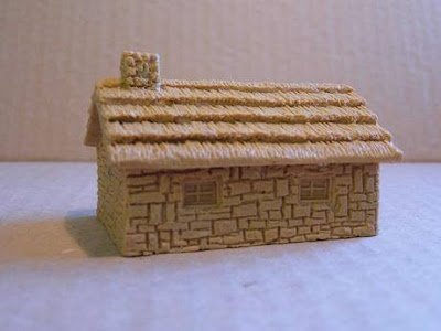 7302 Thatched Stone House