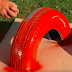 Rugged Dad Spray-Paints Half A Tire. When The Kids See What He's Up To, They Cheer!
