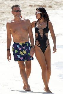 Nigora-Bannatyne-in-an-one-piece-black-swimsuit-at-the-beach-in-Barbados.-z7idk8fge6.jpg