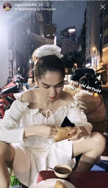 Ngọc Trinh hồn nhiên ngồi ăn ở vỉa hè với tư thế cực thoải mái, tiết lộ thói quen ăn bánh mì rất 'dị' nhưng rất nhiều người cũng có chung sở thích