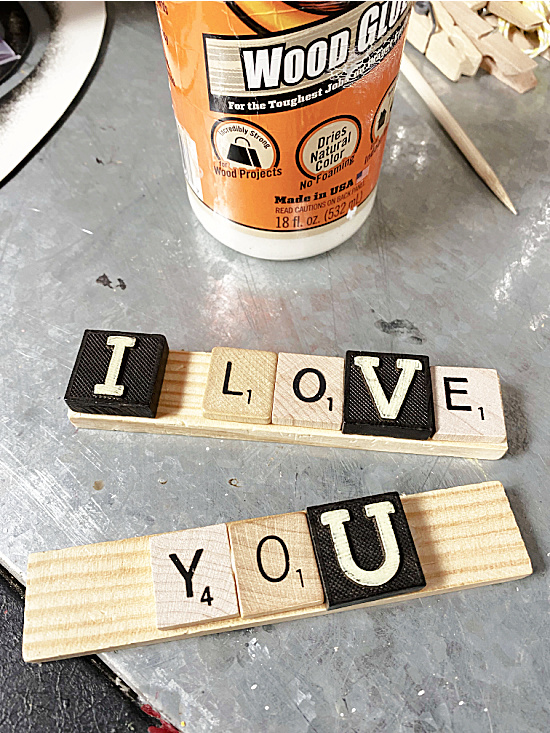 glue bottle and I LOVE YOU Scrabble words