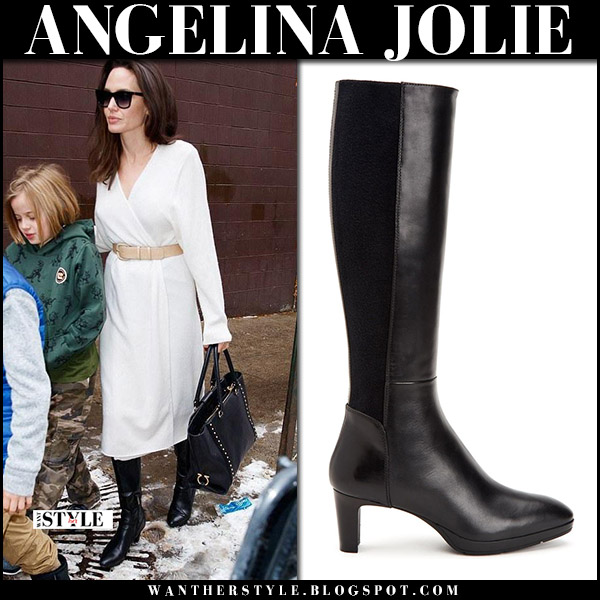 Angelina Jolie in white wrap dress, black boots with black tote salvatore ferragamo street style december 16