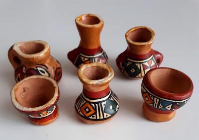 Six peruvian miniature pots.