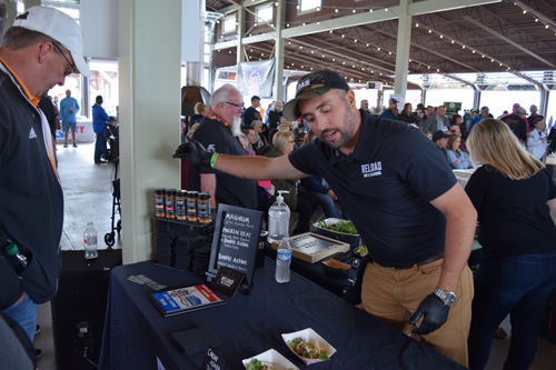 Joel Lickliter of Reload Rub sharing food at the 2019 Scenic City Eggfest