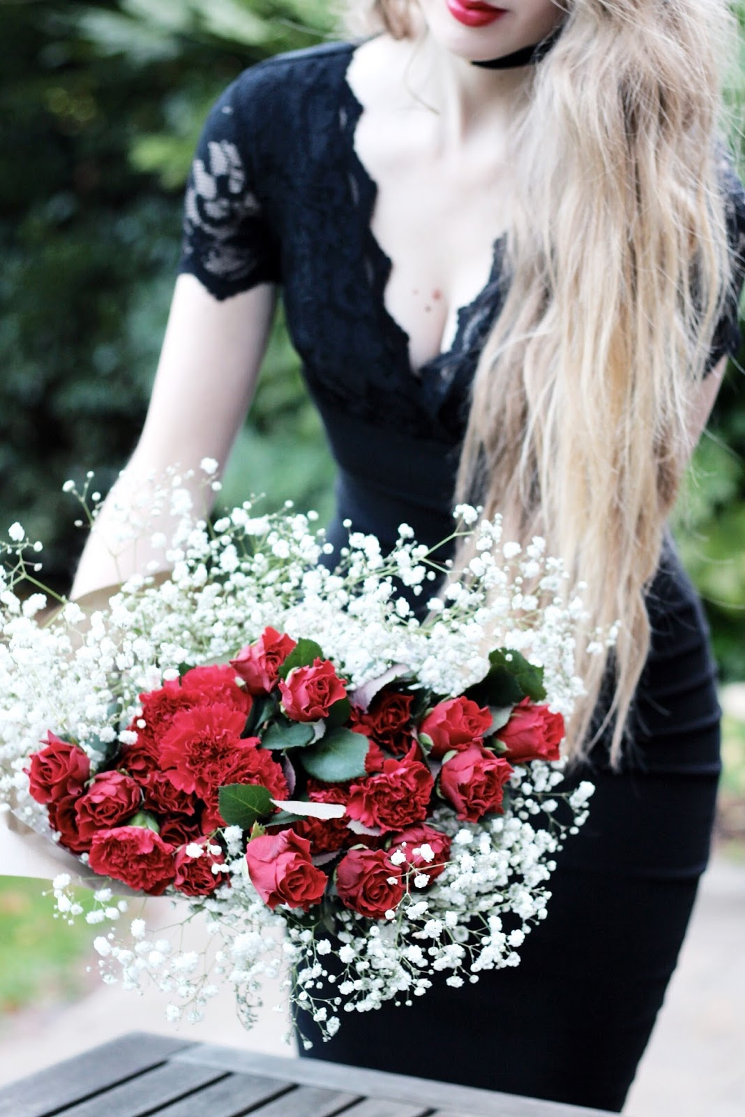 Red roses and carnations luxury Christmas bouquet