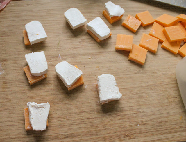 Slicing the cream cheese for making spicy marinated cheese.