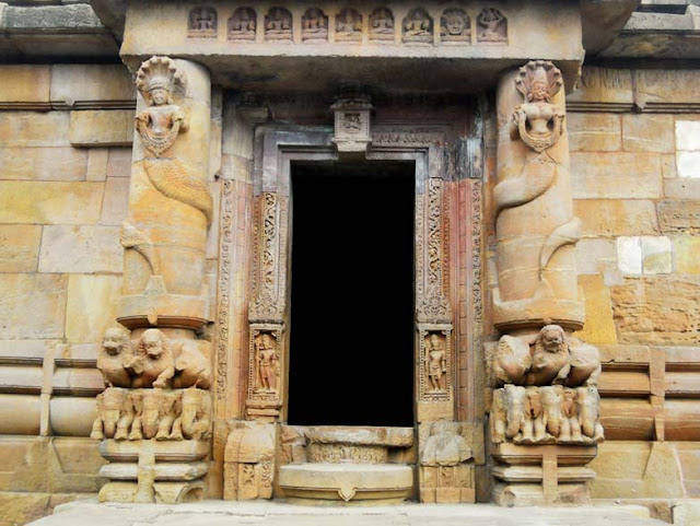 The temple entrance, flanked by round columns entwined by a naga and nagin, at the Rajarani Temple, Bhubaneshwar