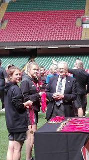Lord Ellis Thomas handing out medals