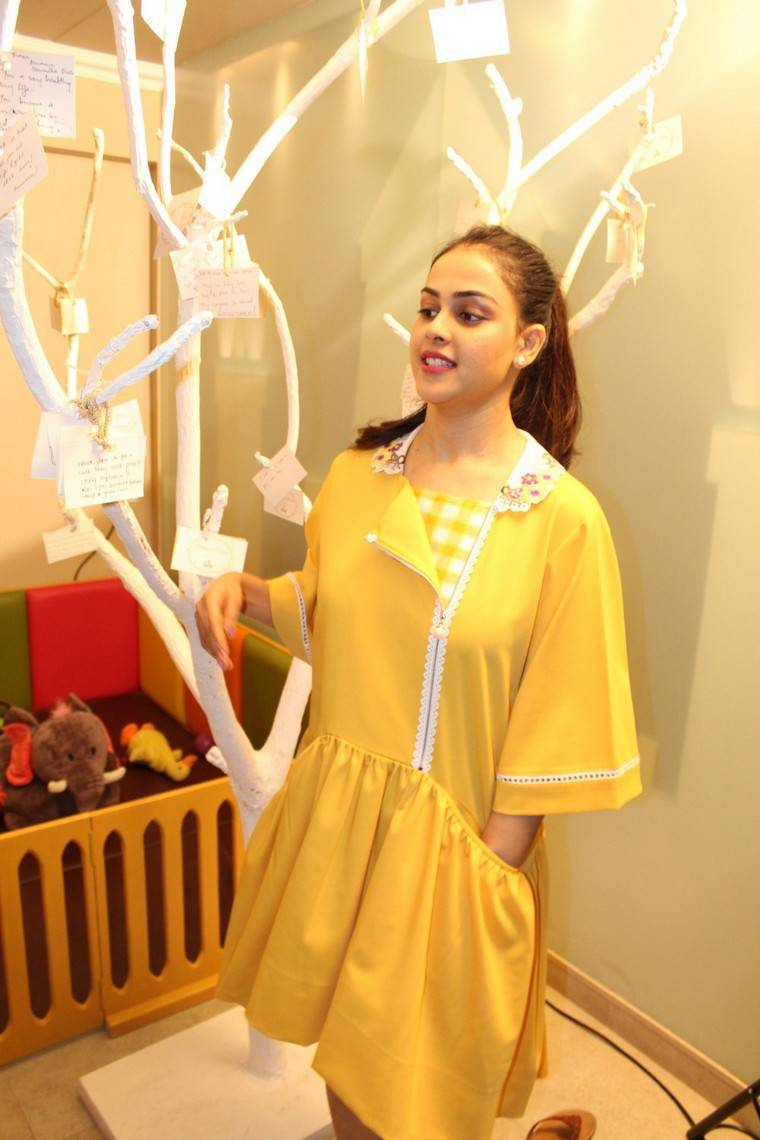 Actress Genelia Stills At Store Launch In Yellow Dress