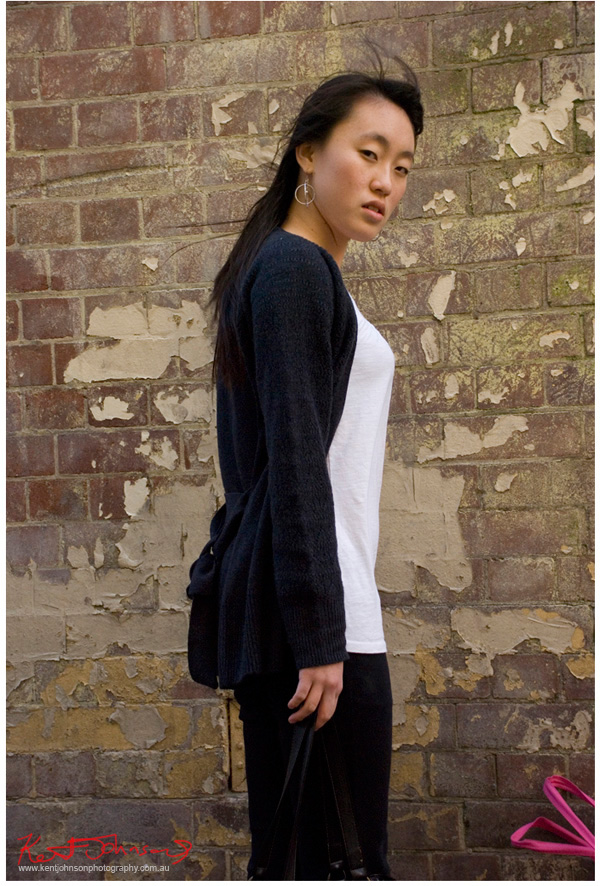 Model sunny in a lane with brick wall and flaking paint as background. Location test, Sydney 2007