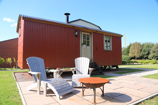 Outside the Shepherd's Hut with a fire pit and chairs at Parkway Hotel and Spa, Cwmbran
