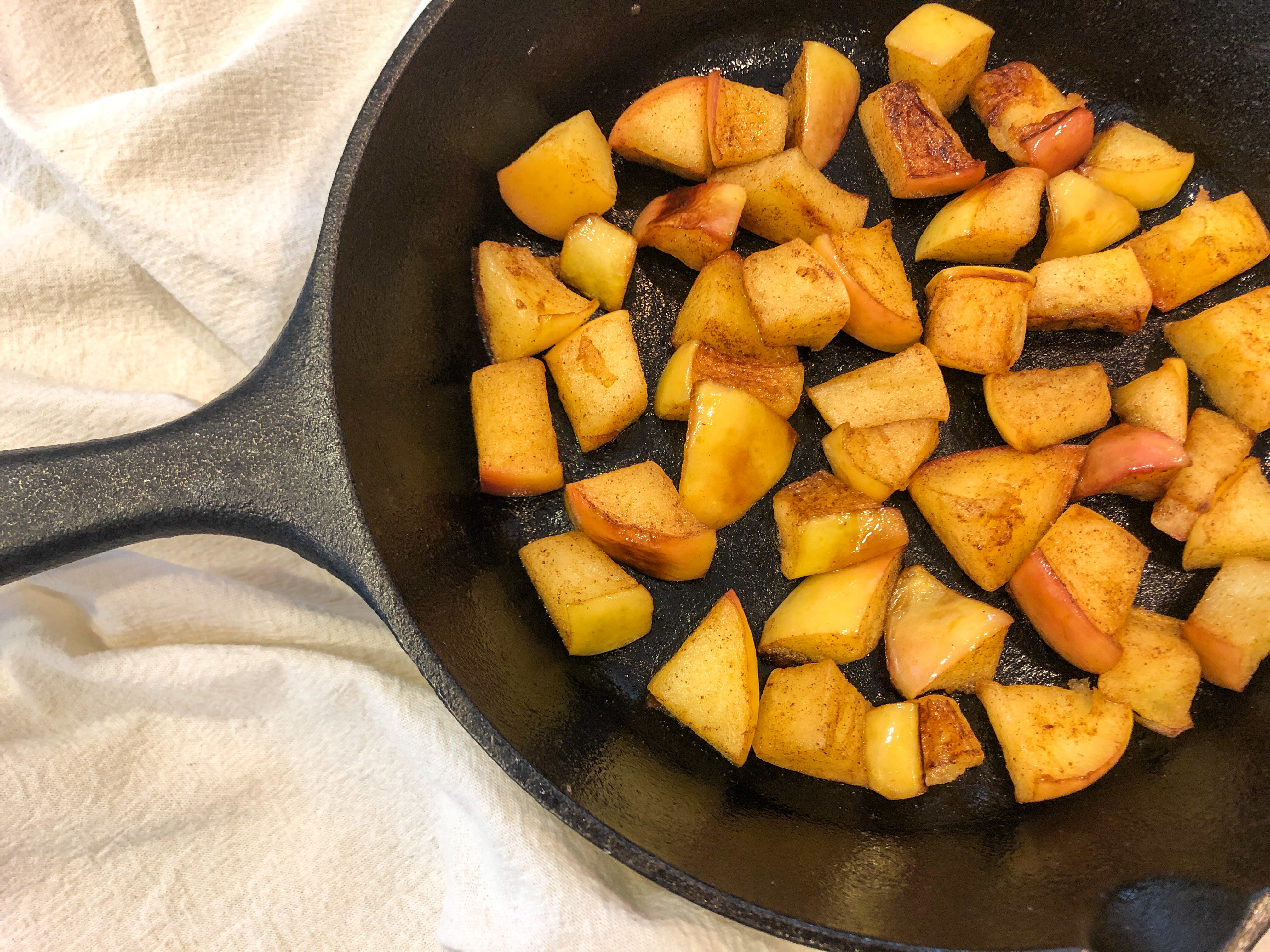 Easy Skillet Double Vanilla Cinnamon Apples Recipe - Easy, delicious spiced apples with a double dose of vanilla! These apples taste like warm apple pie, except they are so simple to make and much healthier. Perfect served with ice cream or yogurt, over pancakes or waffles, and stirred into oatmeal! Dairy-free, gluten-free, grain-free, and refined sugar-free.