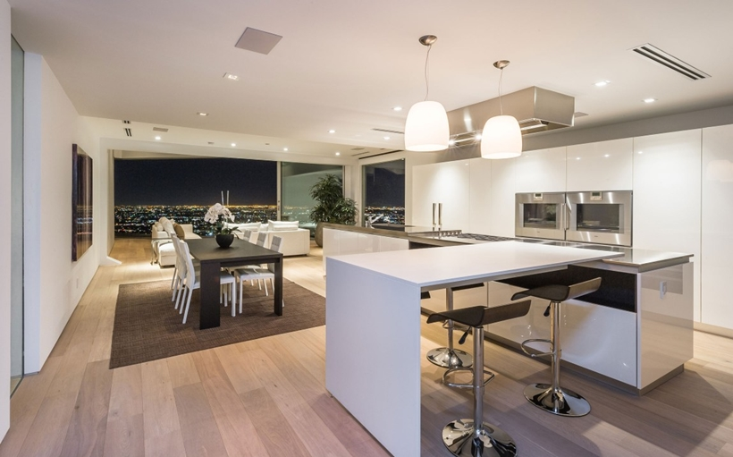 Kitchen and dining room in Sharp modern home on Sunset Strip