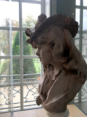 Young girl with roses on her head sculpture in Musée Rodin