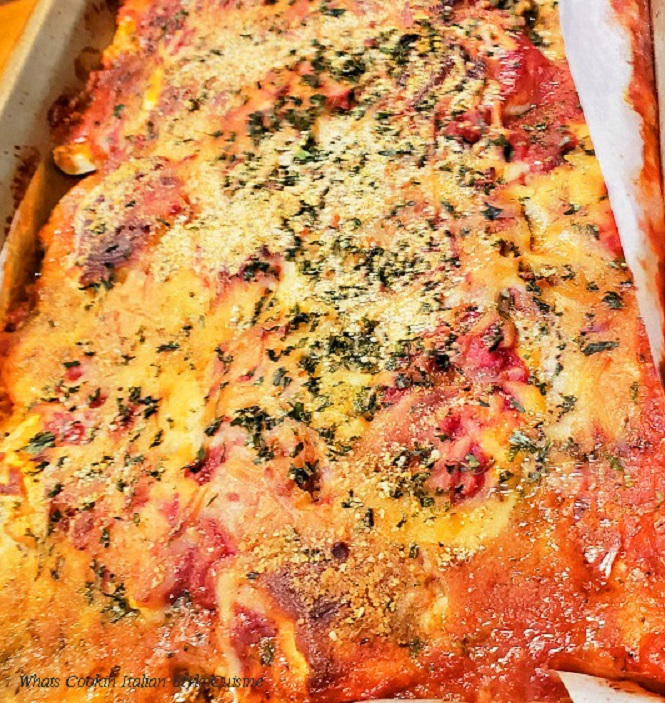 this is a casserole with zucchini made into a lasagna loaded with sauce and cheese
